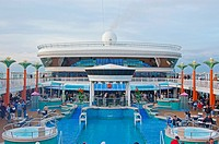 Panoramic view of Oasis poolside at noon, Norwegian Dawn Cruise Ship