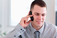 Businessman listening closely yo caller