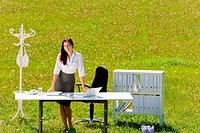 Businesswoman in sunny meadow nature office smile