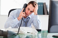 Close up of frustrated businessman on the phone