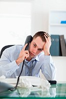 Close up of businessman trying to solve a problem on the phone