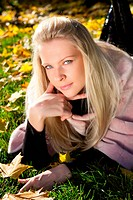 Beautiful russian woman in the autumn park