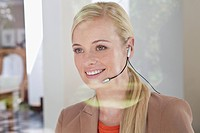 Portrait of smiling woman with headset