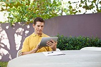 Man using digital tablet (thumbnail)