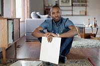 Portrait of man with record album.
