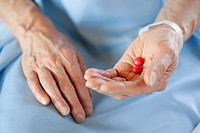 Closeup of hands holding pills