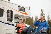 Couple enjoying coffee at campground