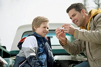 Dad teaching son how to tie a fly