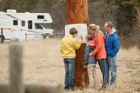 Family reviewing a map at their campsite