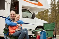 Couple hugging at campground