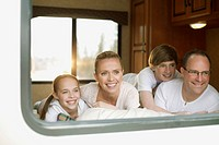 Portrait of family relaxing in camper