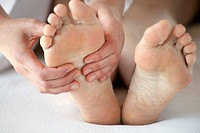 Close_up of feet being massaged