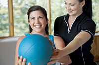 Physical therapist guiding mid_adult woman