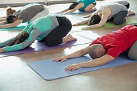 Yoga class in child pose