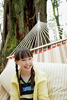 Young girl relaxing in hammock (thumbnail)