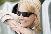 Close_up of mature woman riding in convertible
