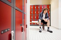 Male college student in the locker room