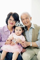 Portrait of grandparents with granddaughter 2_3