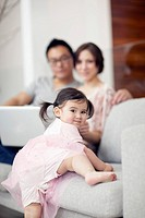 Parents sitting on sofa and looking at daughter 2_3
