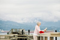 Senior woman on pier at waterfront