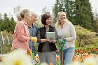 Mature women discussing landscaping plans.