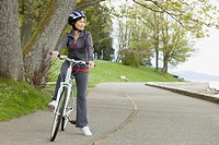 Mature woman riding bike in park