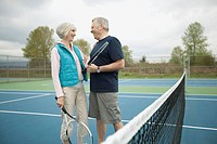 Mature couple on the tennis court