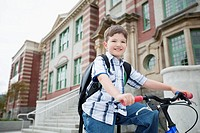 Elementary student biking to school