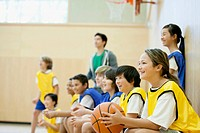 Teacher with basketball teams (thumbnail)
