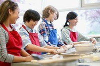 Middle school students in home economics class