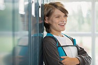 Male middle school student hanging by lockers (thumbnail)