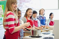 Middle school students in cooking class