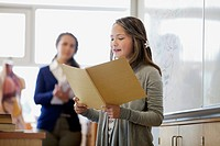 Female middle school student giving presentation