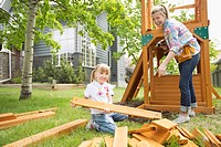 Mom and daughter in backyard with play structure