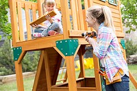 Mature woman building wooden play structure