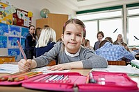 Happy young girl 6_7 sitting in classroom