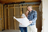 Middle aged couple making renovation plans