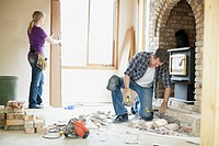 Mid adult couple renovating together (thumbnail)