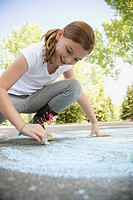 Elementary student creating sidewalk art with chalk (thumbnail)