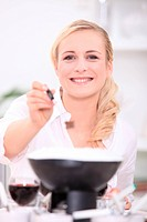 Woman cooking fondue