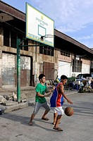 Boys playing basketball on a street in Cebu, Philippines, Southeast Asia, Asia