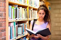Serious female student holding a book