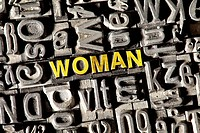Old lead letters forming the word WOMAN