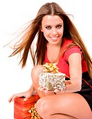 Beautiful shopping girl giving gift box