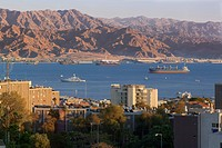 A typical view of the sea and city of Aqaba, Jordan from the residential area of Eilat, Israel In the foreground: streets of Eilat. In the background:...