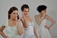 portrait of a three beautiful woman in wedding dress, bride and her friends bridesmaid