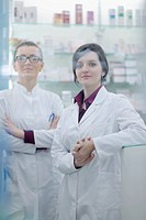 team of pharmacist chemist woman group standing in pharmacy drugstore