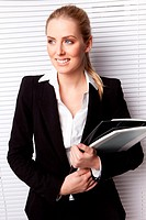 Attractive Blonde Businesswoman With File
