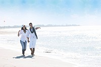 happy young couple in white clothing have romantic recreation and fun at beautiful beach on vacations