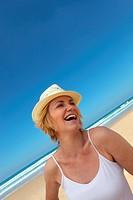 Happy blond woman oat the beach